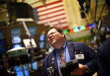 <p>A traders works on the floor of the New York Stock Exchange March 25, 2009. REUTERS/Eric Thayer</p>