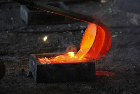 Molten rare earth metal Lanthanum is poured into a mould at Jinyuan Company's smelting workshop near the town of Damao in China's Inner Mongolia Autonomous Region October 31, 2010.  REUTERS/David Gray/Files
