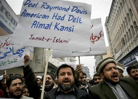 Supporters of the religious and political party Jamaat-e-Islami take part in a protest rally against American Raymond Davis in Peshawar February 11, 2011.  REUTERS/K. Parvez