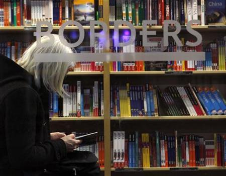 A customer is seen through the window of a Borders book store in New York, March 16, 2010. REUTERS/Brendan McDermid