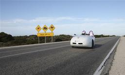 <p>The Wind-Explorer, a wind powered car, is pictured as it is driven by Dirk Gion and Stefan Simmerer, both of Germany, across Australia in this undated handout photo obtained February 15, 2011. The car, fuelled by batteries which are recharged by windmill every night, travelled more than 5000 km (3100 miles) from Perth and arrived in Sydney on Tuesday, according to local media. REUTERS/www.buckle-up.de/Handout</p>