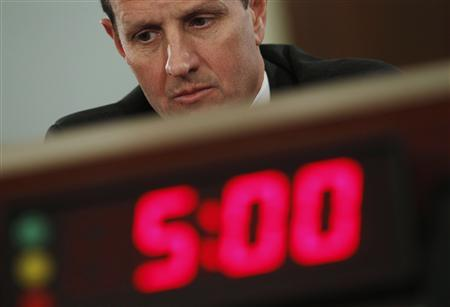 Secretary of Treasury Timothy Geithner listens while testifying before the House Budget Committee on Capitol Hill in Washington, February 16, 2011. REUTERS/Larry Downing