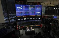 <p>London Stock Exchange CEO Xavier Rolet (L) and TMX Group CEO Tom Kloet speak to the media at the TMX Broadcast centre in Toronto, February 9, 2011. T REUTERS/Mark Blinch</p>