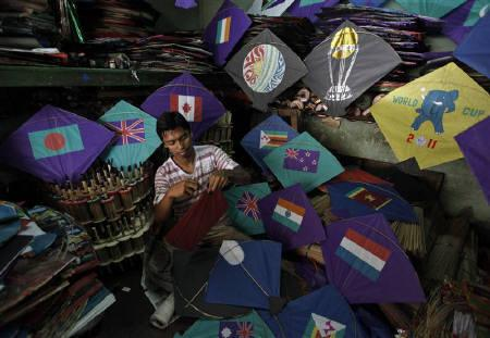 Kite-maker Sikat Dutta makes kites with pictures of the national flags of the countries participating in the upcoming Cricket World Cup, and other World Cup related logos at a workshop in Kolkata February 16, 2011. REUTERS/Rupak De Chowdhuri