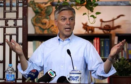 The U.S. Ambassador to China, Jon Huntsman, speaks to an audience gathered in a Beijing bookstore October 25, 2010. REUTERS/Christina Hu