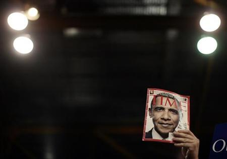 A newsmagazine cover featuring Barack Obama is held up by a supporter during a rally attended by Obama in Chicago, February 11, 2007. REUTERS/Jason Reed