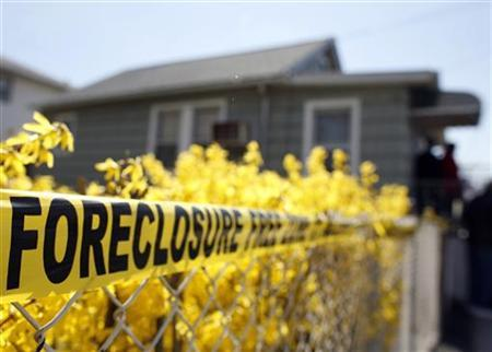 Police tape marked as a Foreclosure Free Zone is seen outside the foreclosed home of Marie Elie in Elmont, New York, April 9, 2009. REUTERS/Shannon Stapleton