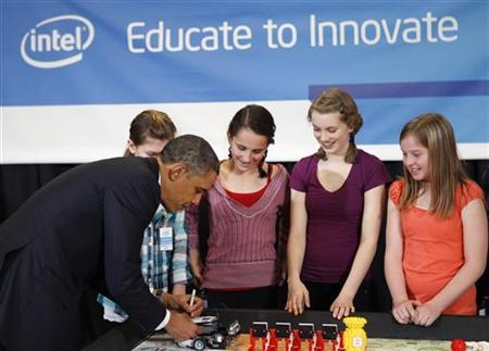 President Obama autographs a Lego robot as he meets student finalists of Intel's Science Talent Search as he tours a semiconductor manufacturing facility at Intel Corporation in Hillsboro, Oregon, February 18, 2011. REUTERS/Kevin Lamarque