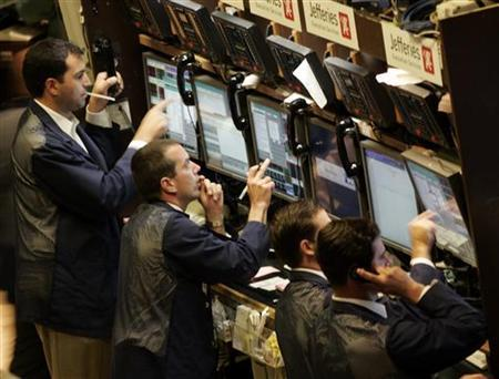 Traders work on the floor of the New York Stock Exchange in New York in this July 9, 2007 file photo. REUTERS/Brendan McDermid
