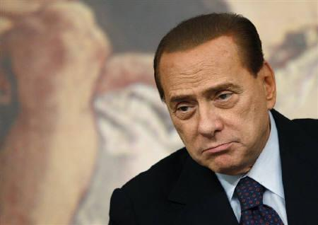 Italy's Prime Minister Silvio Berlusconi looks on during a news conference at Chigi palace in Rome January 26, 2011. REUTERS/Tony Gentile/Files