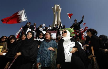 Female lawyers belonging to the Bahrain Lawyers' Society stand among protesters in Pearl Square in Manama February 20, 2011. REUTERS/Hamad I Mohammed