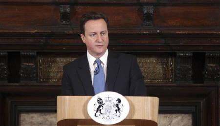 Britain's Prime Minister David Cameron speaks at Toynbee Hall, in East London February 17, 2011. REUTERS/Lewis Whyld/Pool
