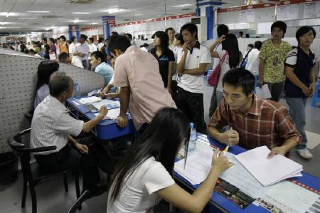 Job seekers are interviewed at a job fair at Longguan Human Resources Market in China's southern city of Shenzhen September 16,2009. REUTERS/Tyrone Siu/Files