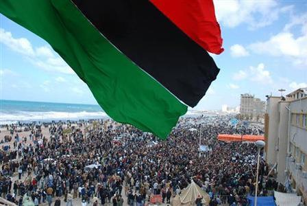 Protesters wave a flag in this undated picture made available on Facebook, February 21, 2011. The image was purportedly taken recently in Benghazi. Reuters/Handout