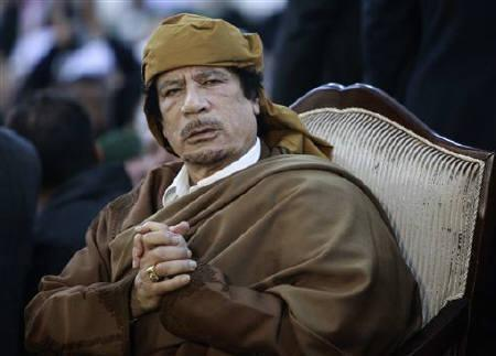 Libyan leader Muammar Gaddafi attends a ceremony marking the birth of Islam's Prophet Mohammed in Tripoli February 13, 2011. Gaddafi fought an increasingly bloody battle to hang on to power on Monday when anti-government protests against his 41-year rule struck the capital Tripoli after days of violence in the east. REUTERS/Ismail Zitouny