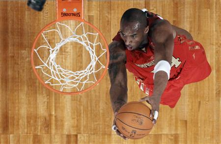 West All Star Kobe Bryant of the Los Angeles Lakers dunks during the NBA All-Star game in Los Angeles, February 20, 2011. REUTERS/Lucy Nicholson