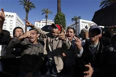 <p>People chant slogans during a protest in Rabat February 20, 2011. Thousands of protesters took to the streets in Morocco on Sunday demanding King Mohammed give up some of his powers, dismiss the government and clamp down on corruption. REUTERS/Youssef Boudlal</p>