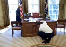 "<p>President Barack Obama (R) examines the ""Resolute Desk"" while visiting with Caroline Kennedy Schlossberg (L) in the Oval Office in this handout photo taken in Washington, March 3, 2009 and later released by the White House. REUTERS/Pete Souza</p>"