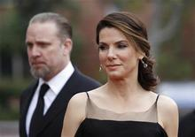 <p>Actress Sandra Bullock (R) and husband Jesse James (L) arrive at the 41st Annual NAACP Image Awards at the Shrine auditorium in Los Angeles, February 26, 2010. REUTERS/Danny Moloshok</p>