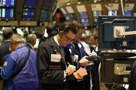 Traders work on the floor of the New York Stock Exchange, February 15, 2011. REUTERS/Joshua Lott