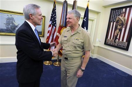 Secretary of the Navy the Honorable Ray Mabus (L) is congratulated by Chief of Naval Operations Adm. Gary Roughead after his swearing in ceremony at the Pentagon in Washington May 19, 2009. Mabus is the 75th Secretary of the Navy. REUTERS/Kevin S. O'Brien/U.S. Navy/Handout