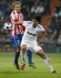 <p>Sami Khedira, do Real Madrid, sofreu grave contusão na coxa esquerda em jogo contra o Olympique Lyon. 13/01/2011. REUTERS/Juan Medina</p>