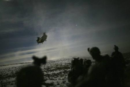 A Chinook helicopter lands to pick up U.S. soldiers of the 101st Airborne Division following a night raid in Yahya Khel, Paktika province February 21, 2011. REUTERS/Matt Robinson