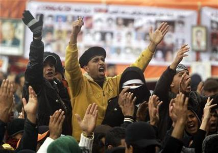 Anti-Gaddafi protesters shout slogans during a protest in Benghazi February 24, 2011. REUTERS/Suhaib Salem
