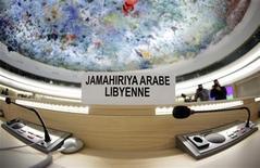 <p>Пустые места делегатов из Ливии на встрече в Женеве, 25 февраля 2011 года. Генеральный прокурор Ливии и солдаты и полицейские города Адждабия перешли в пятницу на сторону демонстрантов, добивающихся отставки Муаммара Каддафи. REUTERS/Denis Balibouse</p>