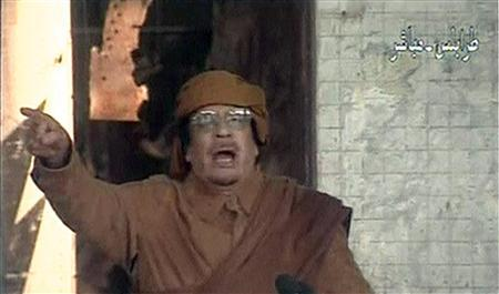 Libya's leader Muammar Gaddafi speaks on national television from Tripoli in this February 22, 2011 still image taken from video footage. REUTERS/Libyan State Television/Handout