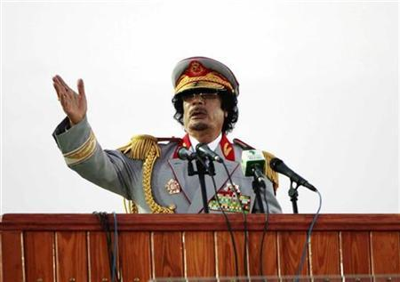 Libyan leader Muammar Gaddafi speaks during a ceremony to mark the 40th anniversary of the evacuation of the American military bases in the country, in Tripoli, June 12, 2010. REUTERS/Ismail Zetouny