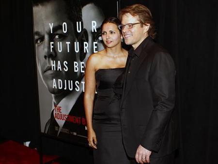 Actor Matt Damon (R) and his wife Luciana Bozan Barroso attend the premier of ''The Adjustment Bureau'' at the Ziegfeld Theatre in New York February 14, 2011. REUTERS/Joshua Lott