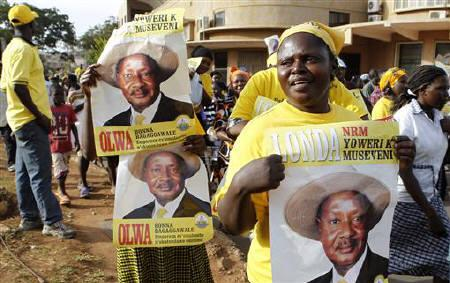 Supporters of Uganda's President Yoweri Museveni celebrate his victory in the Presidential elections along the streets of the capital Kampala, February 20, 2011. REUTERS/Thomas Mukoya