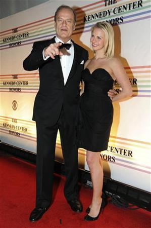 Kelsey Grammar (L) and Kayte Walsh (R) arrive on the red carpet for the Kennedy Center Honors at the Kennedy Center in Washington, December 5, 2010. REUTERS/Jonathan Ernst