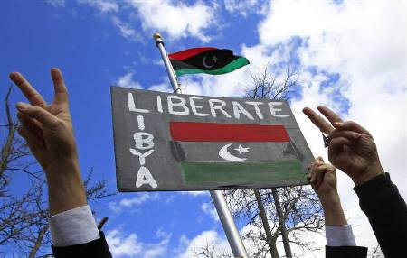 Libyan-Americans gesture during a protest against Muammar Gaddafi, at the residence of the Libyan ambassador, in Washington February 25, 2011. REUTERS/Jim Young