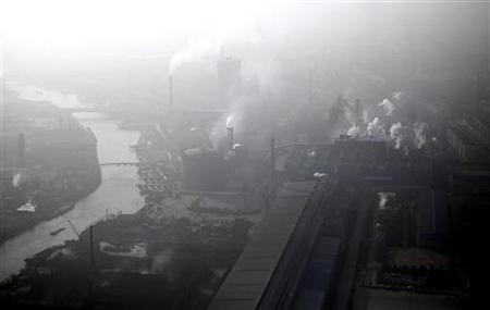 Pollution is seen over an industrial area of Huaxi village, at Jiangsu province December 3, 2010. REUTERS/Carlos Barria
