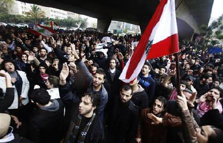 Protesters shout slogans and carry Lebanese flags during a demonstration against Lebanon's sectarian political system and alleged corruption, near the Justice Palace in Beirut, February 27, 2011. REUTERS/ Khalil Hassan