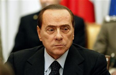 Italy's Prime Minister Silvio Berlusconi looks on as he attends an extraordinary meeting for the Libyan crisis in Rome February 22, 2011. REUTERS/Max Rossi