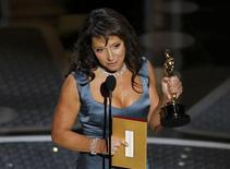 "<p>Director Susanne Bier accepts the Oscar for best foreign film for the Danish film ""In A Better World"" during the 83rd Academy Awards in Hollywood, California, February 27, 2011. REUTERS/Gary Hershorn</p>"