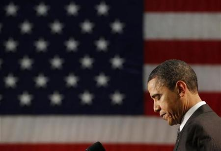 President Obama pauses while speaking at Cleveland State University in Ohio, February 22, 2011. REUTERS/Larry Downing