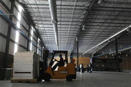 A man drives a fork lift at an industrial building in Saltillo, Mexico, January 25, 2011. REUTERS/Tomas Bravo