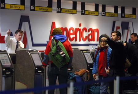 Passengers check-in at the American Airlines ticket counter at Logan International Airport in Boston, Massachusetts January 5, 2010. REUTERS/Brian Snyder (UNITED STATES - Tags: BUSINESS TRANSPORT)