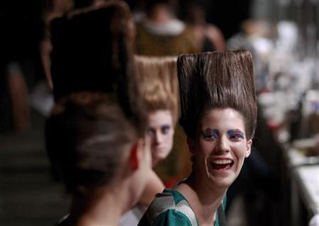 A model laughs while talking to other models backstage before the Varanasi 2011 Fall/Winter collection show during Buenos Aires Fashion Week, February 22, 2011. REUTERS/Marcos Brindicci