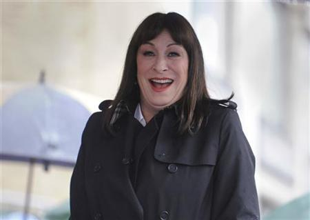 Actress Anjelica Huston attends a ceremony where she received a star on the Hollywood Walk of Fame in Los Angeles, January 22, 2010. REUTERS/Phil McCarten