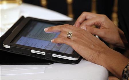 South Carolina Governor Nikki Haley types on her iPad during a meeting with a bipartisan group of governors in the State Dining Room at the White House in Washington February 28, 2011. REUTERS/Kevin Lamarque