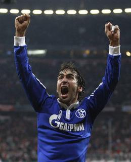 Schalke 04's Raul celebrates following their victory over Bayern Munich in their German soccer cup (DFB-Pokal) semi-final match in Munich, March 2, 2011. REUTERS/Alex Domanski