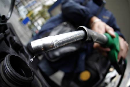 A customer fills his motorcycle at a petrol station in Nice, southeastern France, March 2, 2011. REUTERS/Eric Gaillard