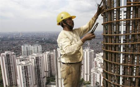 A man works on a skyscraper building in Jakarta April 2, 2008. REUTERS/Supri/Files