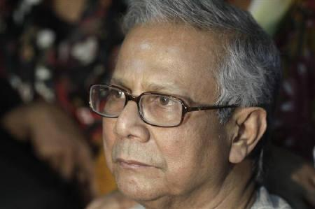 Bangladeshi Nobel laureate Muhammad Yunus appears in front of the media with his lawyers after a hearing in the High Court in Dhaka March 3, 2011. REUTERS/Andrew Biraj