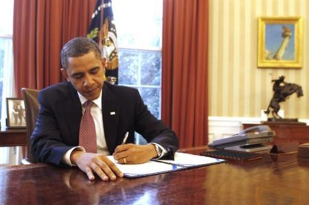 President Obama signs H.J. Resolution 44, a two-week continuation for the U.S. government, in the Oval Office, March 2, 2011. REUTERS/Larry Downing